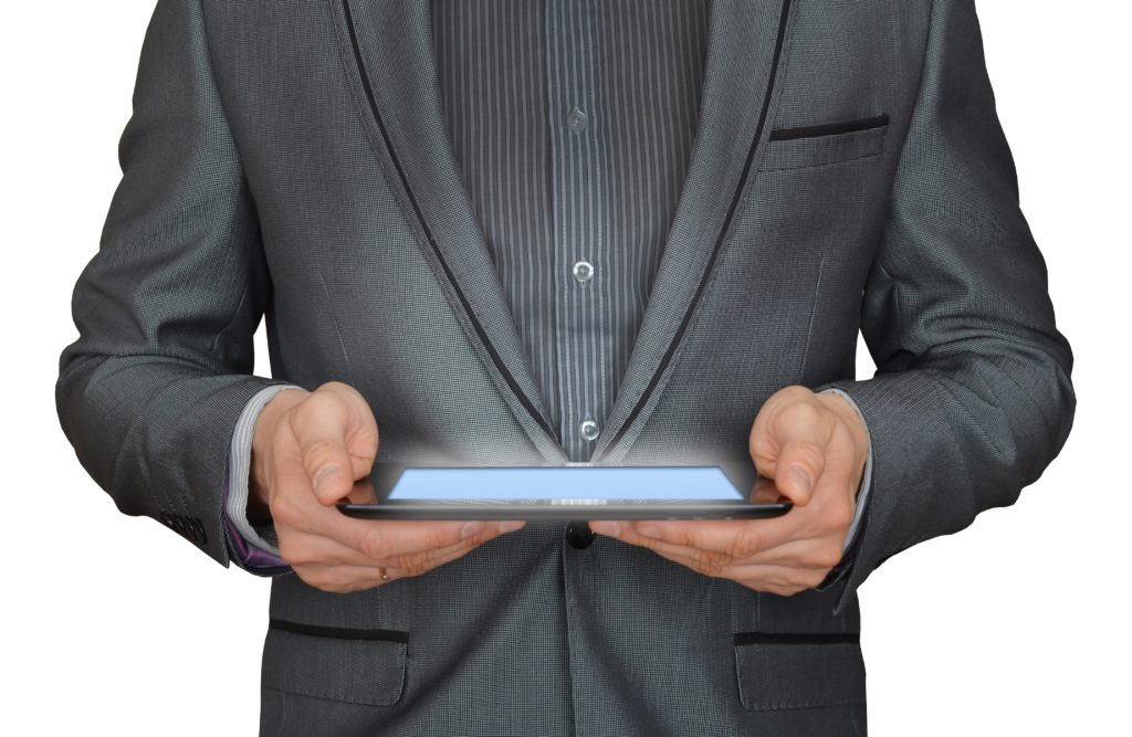 Business man holding a tablet in his hands