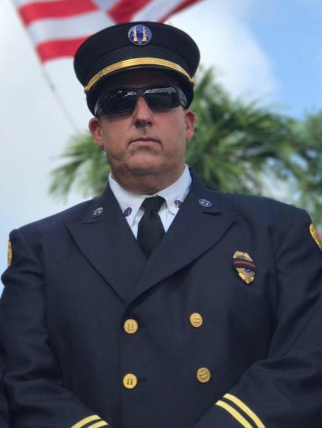 Matt Hyman standing in military uniform