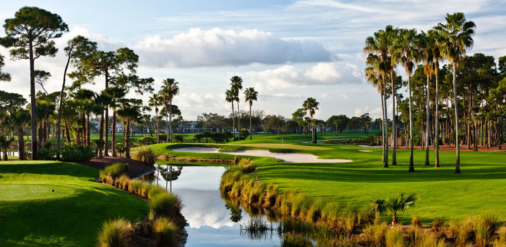 Golf course and lake with palm trees in Palm Beach Gardens, FL