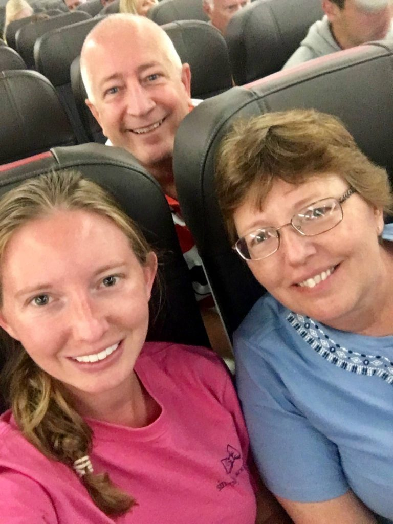 Laura is on the plane with her family